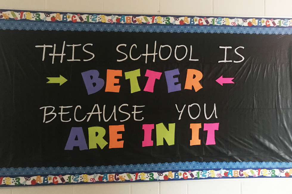"""Green Chimneys School bulletin board displays the message, """"This school is better because you are in it."""""""
