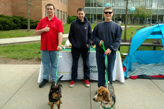 Image of Green Chimneys School students with rescue dogs at a community event