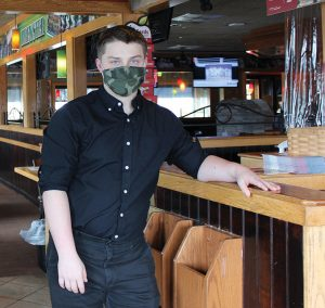 Images shows Green Chimneys student at Applebee's as part of his vocational education experience.